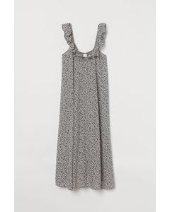 Kleid mit Volant Schwarz/Weiß geblümt