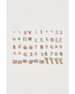 25 Par Studs Guld/bokstäver