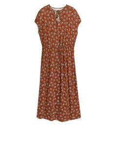 Jersey-Kleid mit floralem Muster Dunkelorange