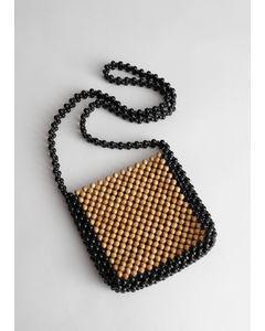 Crossbody tas van hout met kralen bruin