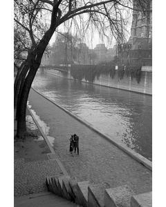A Couple Walking Along The Seine River In Paris.1940