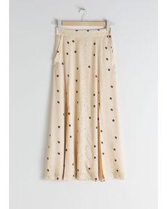 Sophy mönstrad midi-kjol i satin beige