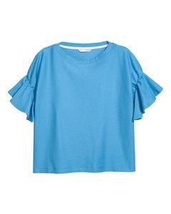 Top with flounced sleeves Sky blue
