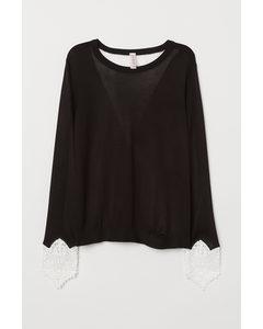 Pullover mit Spitzendetails Schwarz