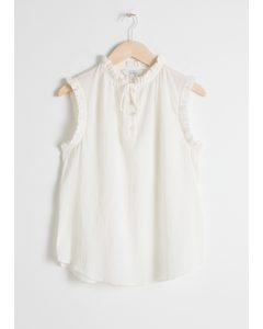 Frill Sleeveless Blouse White