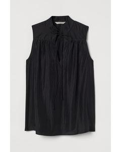 Ärmellose Bluse zum Binden Schwarz