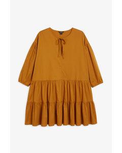 Kleid mit Volantsaum Senfgelb