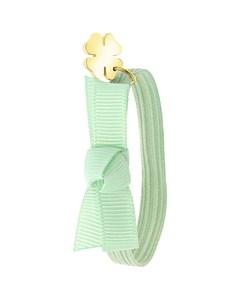 Elastisches Kinderarmband in Grün mit Kleeblatt-Anhänger