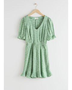 Minikleid mit V-Ausschnitt und Puffärmeln Grün/Geblümt