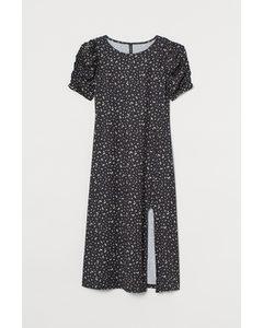 Kleid mit Puffärmeln Schwarz/Klein geblümt