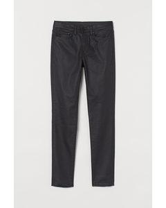 Skinny Coated Jeans Schwarz