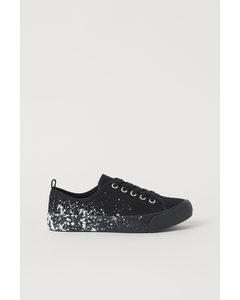 Sneaker aus Canvas Schwarz/Farbspritzer