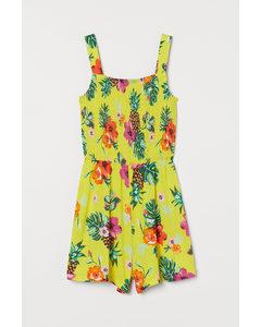 Gesmokter Playsuit Gelb/Tropische Blüten