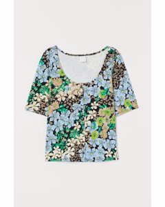 Shirt mit tiefem Ausschnitt Schwarz/Grün geblümt