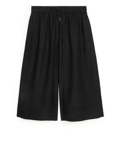 Fließende elastische Culottes Schwarz