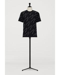 T-Shirt mit Nieten Schwarz