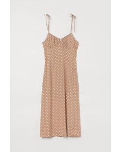 Kleid mit Schlitz Beige/Gepunktet