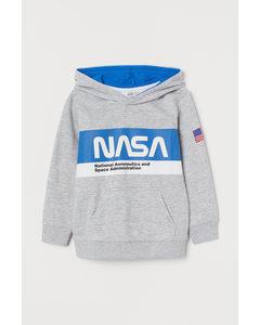 Hoodie mit Motiv Hellgraumeliert/NASA