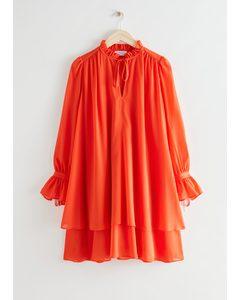 Minikleid in A-Linie mit Volantrock und Volantbesatz Orange
