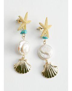 Ohrringe mit Perl- und Muschelanhängern Türkis/Gold
