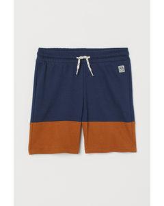 Blockfärgade Sweatshirtshorts Marinblå/brun