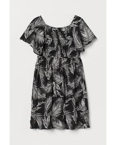 Gesmoktes Kleid Schwarz/Palmenblätter
