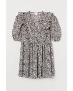 Kleid mit Puffärmeln Schwarz/Weiß geblümt