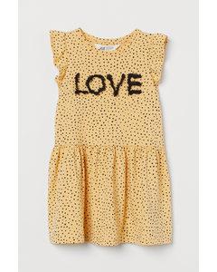 Kleid mit Motiv Gelb/Love