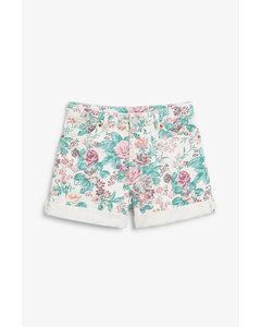 Jeansshorts mit umgeschlagenen Beinabschlüssen Floraler Print