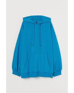 Oversized Capuchonsweater Helderblauw