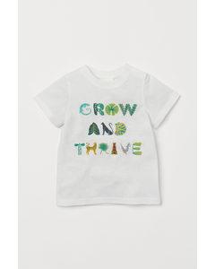 T-Shirt mit Druck Weiß/Grow and Thrive