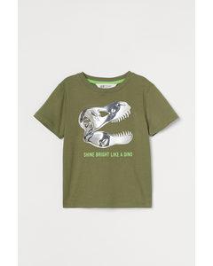 T-Shirt mit interaktivem Motiv Khakigrün/Dinosaurier