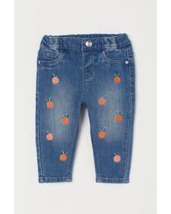 Bestickte Jeans Blau/Apfelsinen