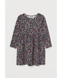 Kleid aus Baumwolljersey Dunkelgrau/Lila geblümt