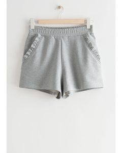 Fleece-Shorts mit gerüschten Taschen Graumeliert