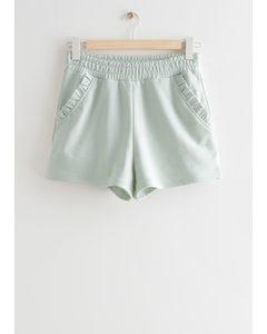Fleece-Shorts mit gerüschten Taschen Mint