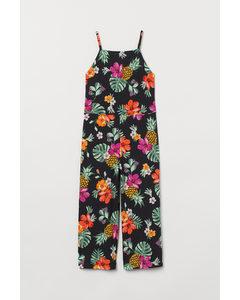 Gerippter Jumpsuit Schwarz/Tropische Blüten